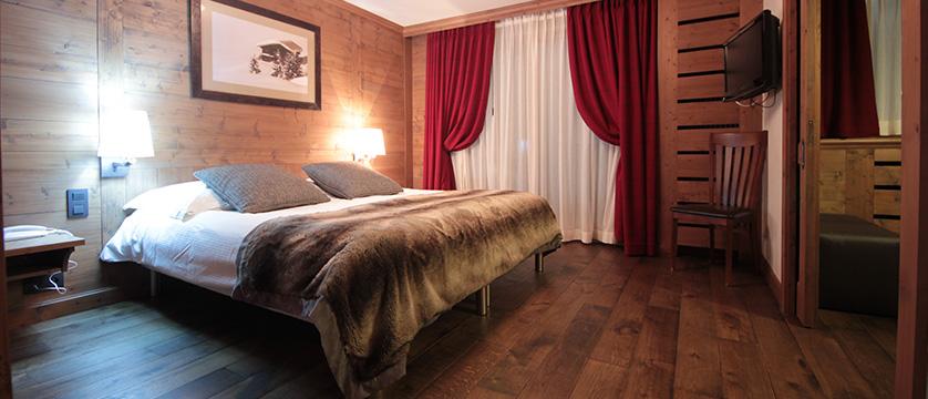 Hotel Les Champs Fleuris, Morzine, France - deluxe bedroom.jpg